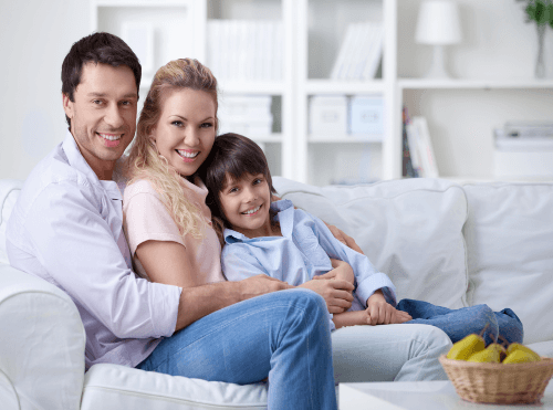 happy family on couch after air authority fixes