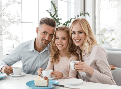 family drinking tea smiling